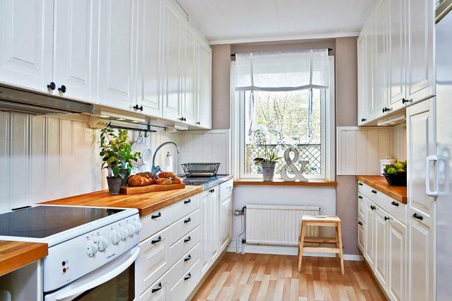 Двурядное расположение мебели на кухне
